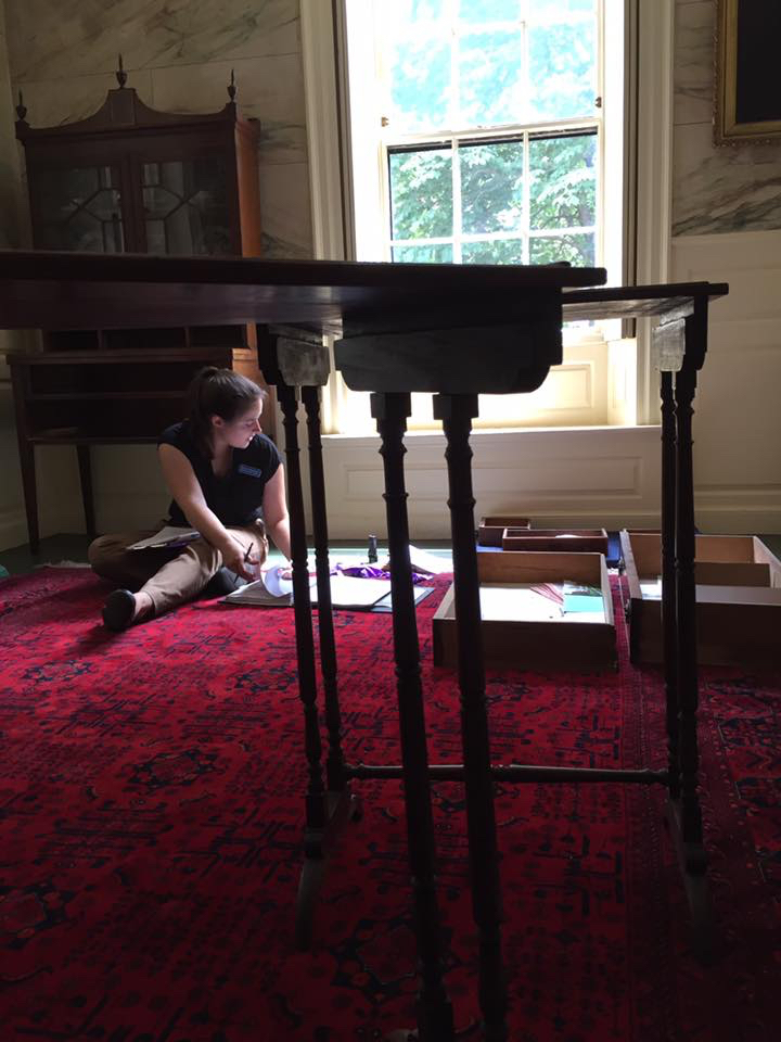 BFA intern Melissa examines each individual drawer for marks, while my nesting tables in the foreground turned out to have quite a few dowels loose