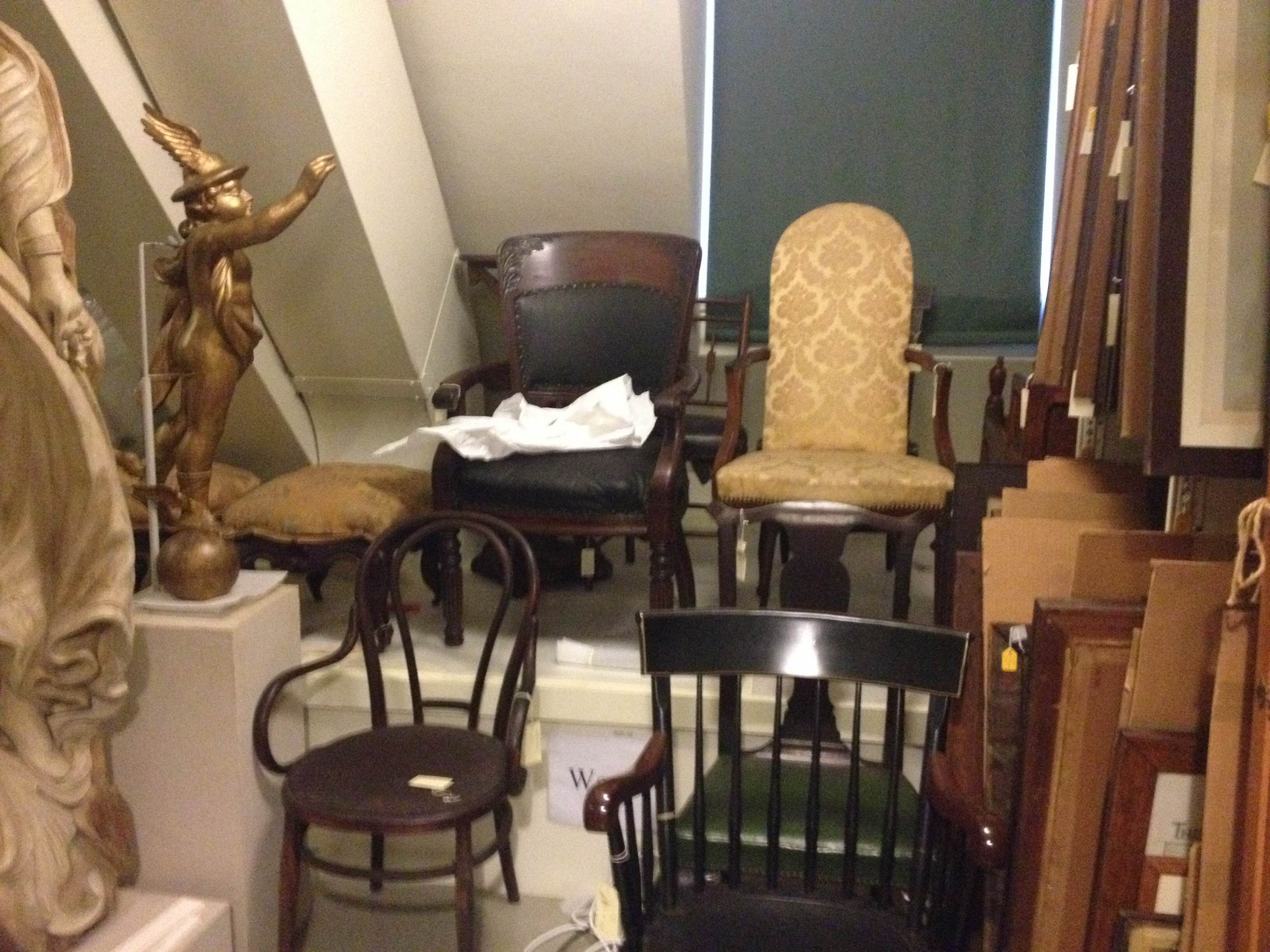 An example of the diverse holdings of chairs from the Bostonian Society, and the problems their surroundings presented when it came to moving them.