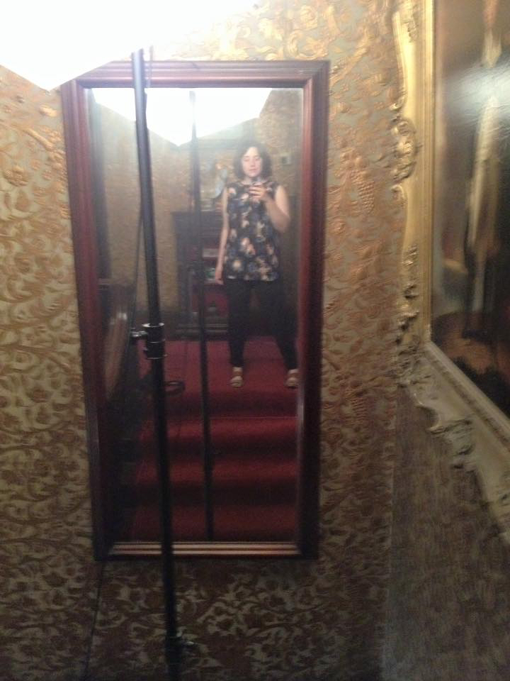 A selfie taken in a moment of rest in between shooting at the Gibson House. Between the lights, carpet, and insulating wallpaper, it was a very hot stairway.