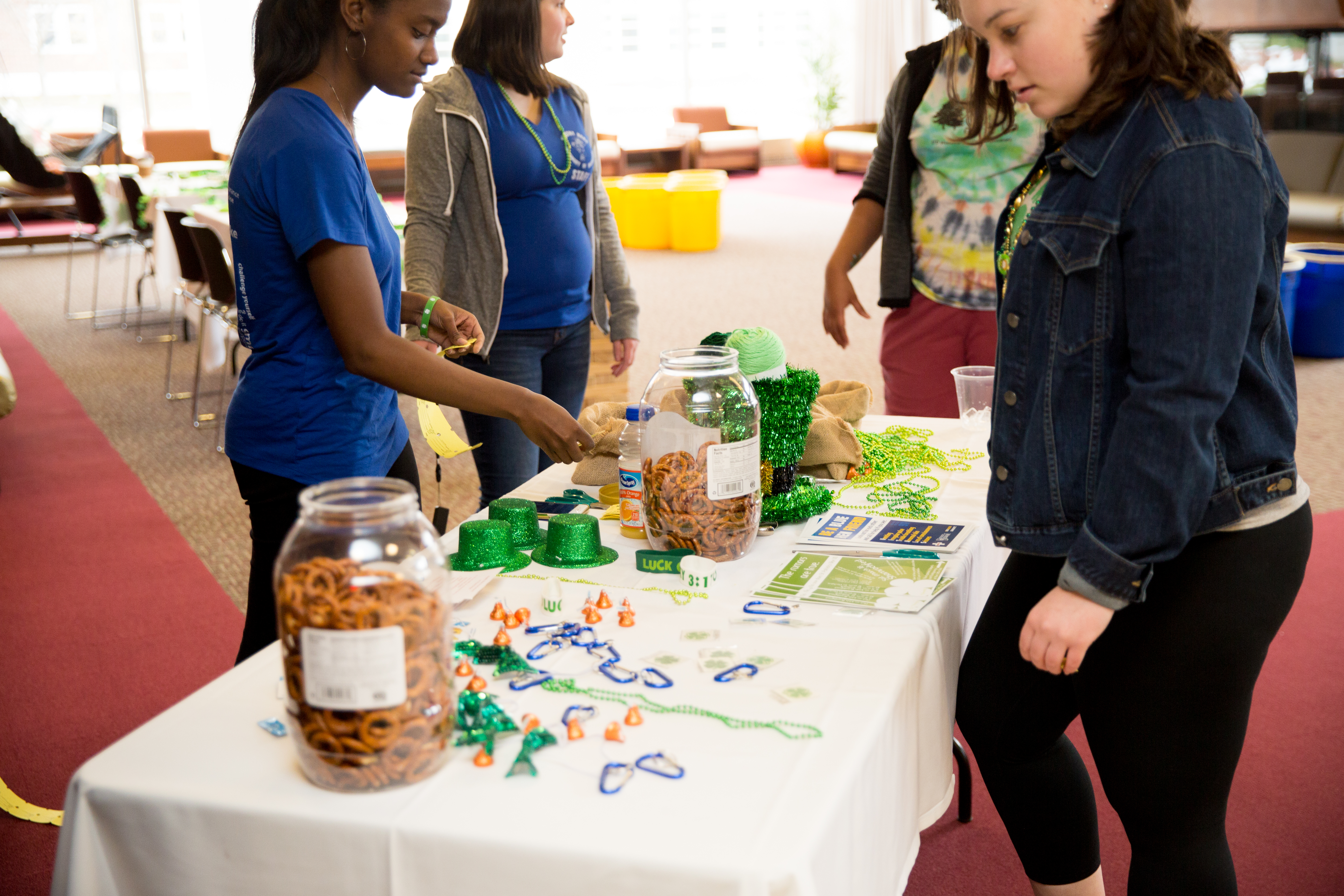 Healthy HENS students giving away pretzels and Shamrock Fest toys