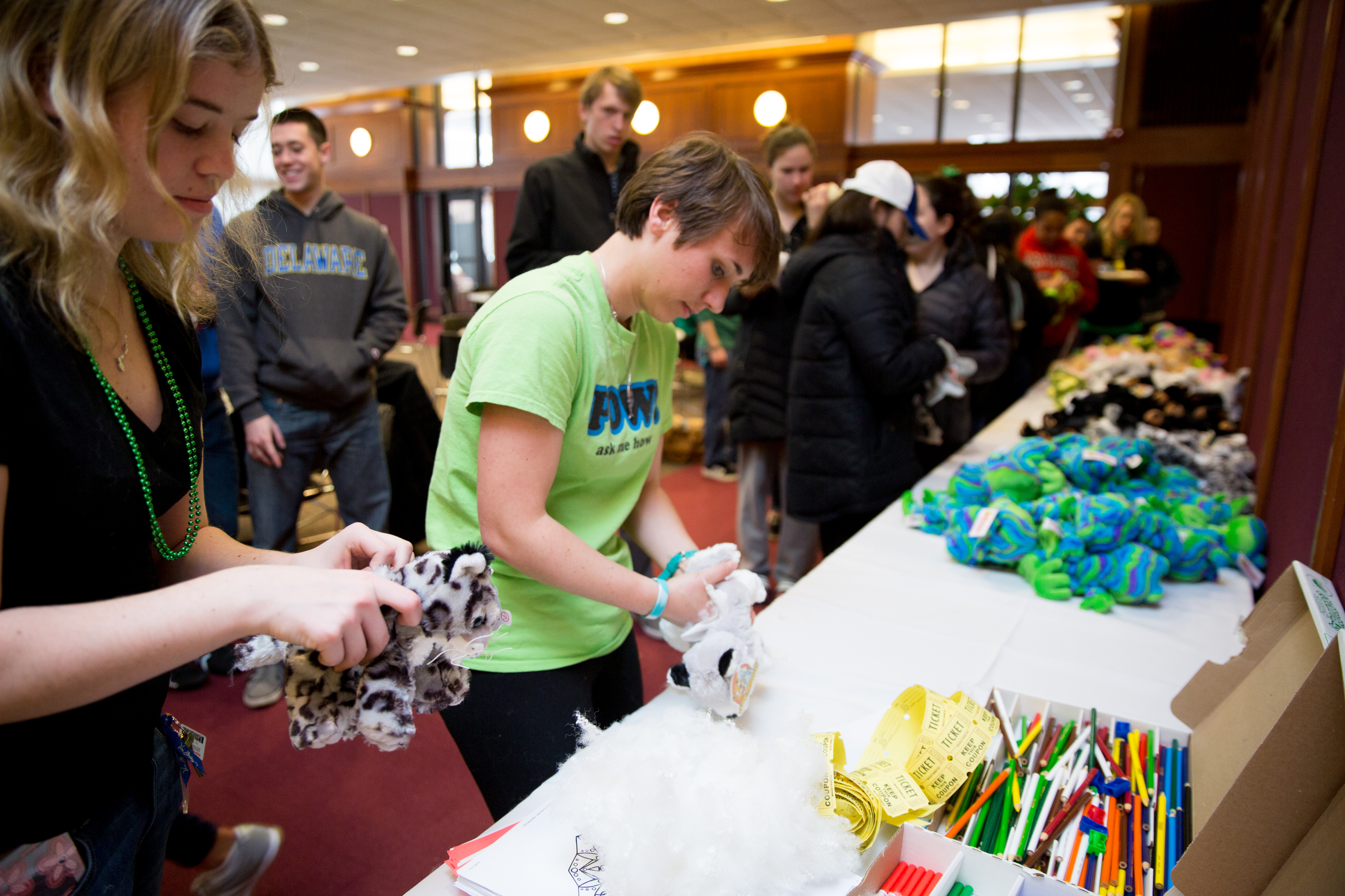 "Students getting ""stuff an animal"" stuffed animal toys at Shamrock Fest"