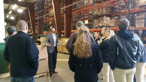 Matthew Talley of Food Bank of Delaware speaks with the group