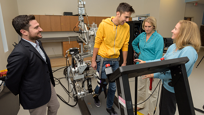 UD researchers (from left) Fabrizio Sergi, Darcy Reisman and Jill Higginson monitor a student's gait.