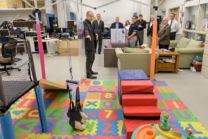 """Kids with Confidence, a Delaware nonprofit program that helps children with physical """"differences"""" regain their self-assurance [http://kidswithconfidence.org/], making a donation to Cole Galloway's """"GoBabyGo!"""" pediatric mobility program. - (Evan Krape / University of Delaware)"""