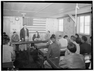 Roy Takano [i.e., Takeno] at town hall meeting, Manzanar Relocation Center, California, [1943]. Source: Ansel  Adams, Manzanar War Relocation Center photographs, Library of Congress Prints and Photographs Division Washington, D.C.