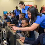 Students participate in College of Engineering's Hour of Code at Elbert Palmer Elementary School.