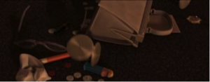 The contents of a victim's purse dumped on the ground during a random mugging, from the beginning of my favorite Pixar movie.