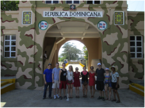 Our group on the Dominican side of the border with Haiti in the background.
