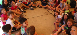 My co-counselors, campers, and I sitting in a circle during our weekly song session.