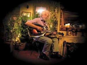 Lowell Levinger playing at the QueCumBar French Cafe in London, England. 11/1/15