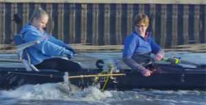 QuadCrew team member Molly Wessel tests the adaptive rowing device on the water, under the watchful eyes of Prof. Jenni Buckley, Mechanical Engineering