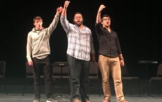 Cast members Benjamin Dutton, Travis Lucas, and Ethan Udovich (l. to r.) rehearsing a scene from Act I of Mozart's Cosi fan tutte