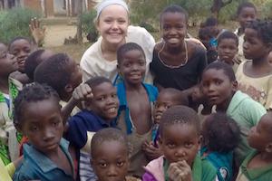 EWB posing with children in Malawi