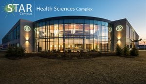 Exterior photos at dusk of the Health Sciences Complex (HSC) on the Science, Technology, and Advanced Research (STAR) campus.