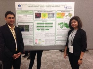 Photo of Abdul Qadir and Pinki Mondal at the American Association of Geographers Conference in Washington, DC.