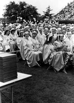 Several happy graduates of the University of Delaware smile for the camera during the 1981 commencement