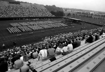 A crowd of relatives and friends watch the 1979 University of Delaware commencement ceremony at Delaware Stadium