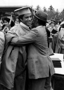 A new graduate of the University of Delaware receives congratulations during commencement in 1979