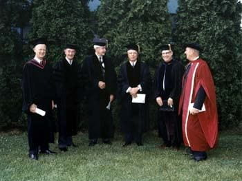 Three honorary degree recipients chat with members of the University of Delaware administration at the 1968 commencement. Pictured here from left to right are James M. Tunnell Jr. (President of the Board of Trustees), George P. Edmonds (an honorary degree recipient), William Maurice Ewing (an honorary degree recipient and commencement speaker), John Alanson Perkins (an honorary degree recipient and former President of the University), John W. Shirley (Acting President of the University), and Samuel Lenher (a member of the Board of Trustees).