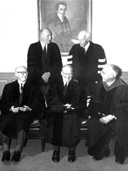 Four notable individuals received honorary degrees from the University of Delaware during the commencement of 1965. Pictured here from left to right in the back row are Alfred Elliott Bissell and Walter S. Carpenter Jr.; from left to right in front of them are Edward Whitney Cannon, Caryl Parker Haskins (the commencement speaker), and John Alanson Perkins (the President of the University of Delaware).