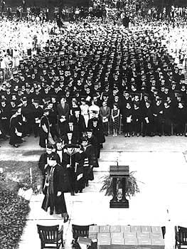 The graduating class of 1960 assembled on the North Mall in front of Hullihen Hall. G. Cuthbert Webber, Professor of Mathematics, leads the procession of administration and trustees to the podium.