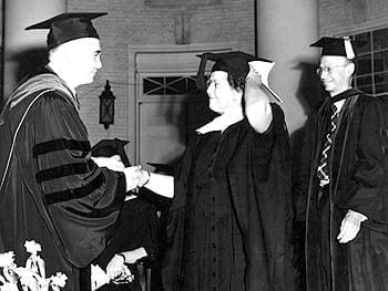 Mary Collison Fraim receives her honorary degree from John Alanson Perkins, the President of the University of Delaware, during the 1954 commencement. Behind her stands Allan Philip Colburn, Provost of the University.