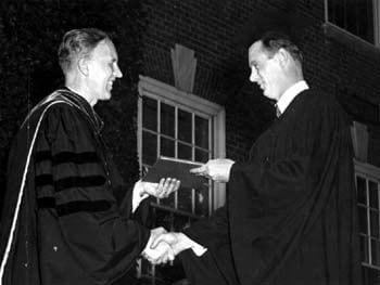 William Samuel Carlson, President of the University of Delaware, presents a B. A. diploma to William C. Parvis during the commencement in 1949.