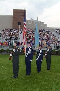 An honor guard composed of members of the University of Delaware Army and Air Force ROTC programs participates in the 2003 commencement ceremonies.