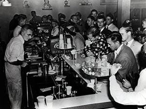 Photograph of the original Scrounge student snack bar, located in the basement of Memorial Library. Circa 1949.