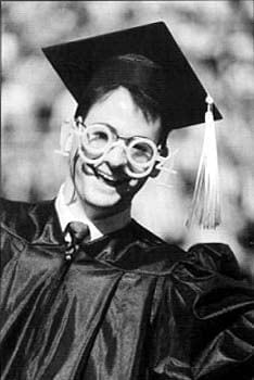 Can you tell that this happy graduate is a member of the class of 1994?