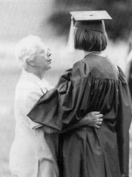 A graduate of the class of 1998 receives congratulations after commencement.