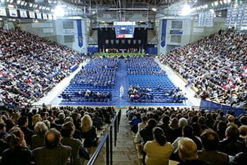 Family and friends gather in the Bob Carpenter Center to view the Winter 2002 commencement proceedings.