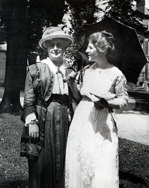 Photograph of Emalea Pusey Warner and Dean Winifred Josephine Robinson talking, taken shortly before the opening of the Women's College of Delaware. August 7, 1914.