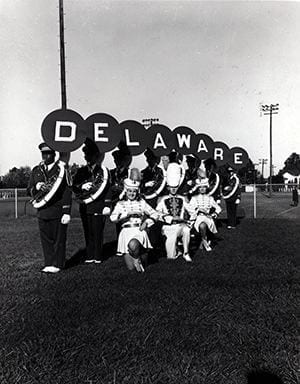 Posed Photograph of members from the University Delaware Marching Band. Photograph taken during 1964- 1965 academic year.
