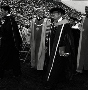 Photograph of Dr. William Homer, University President E. A. Trabant, Dr. Samuel Lenher (chair of the board of trustees), commencement speaker Dr. R. Buckminster Fuller, The Honorably Elbert N. Carvel (vice chair of the board and former governor of the state of Delaware) during a commencement ceremony. May 1980.
