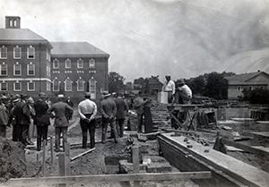Photograph of the laying of the cornerstone ceremony for Evans Hall. 1928.