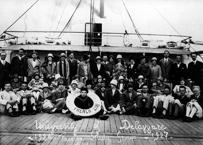 UD study abroad students in the 1926-27 group on the deck of the ship sailing to France.