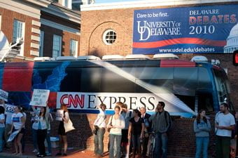 Students and CNN Express bus outside Mitchell Hall.