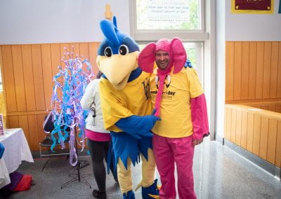 YouDee, the University's mascot along with a person representing the elephant in the room, challenging the stigma associated with mental health struggles