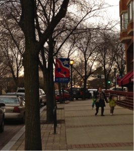 Example of healthy streetscape with wide side walks for pleasant walking environment, trees, and on-street parking.