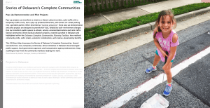 A screenshot of the opening page of the Tactical Urbanism GIS story map which features a young girl smiling as she helps to paint lines on the street for a pop-up projects.