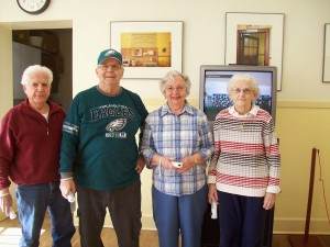 Photo of seniors playing a Wii console game together. Image of a aging-friendly community