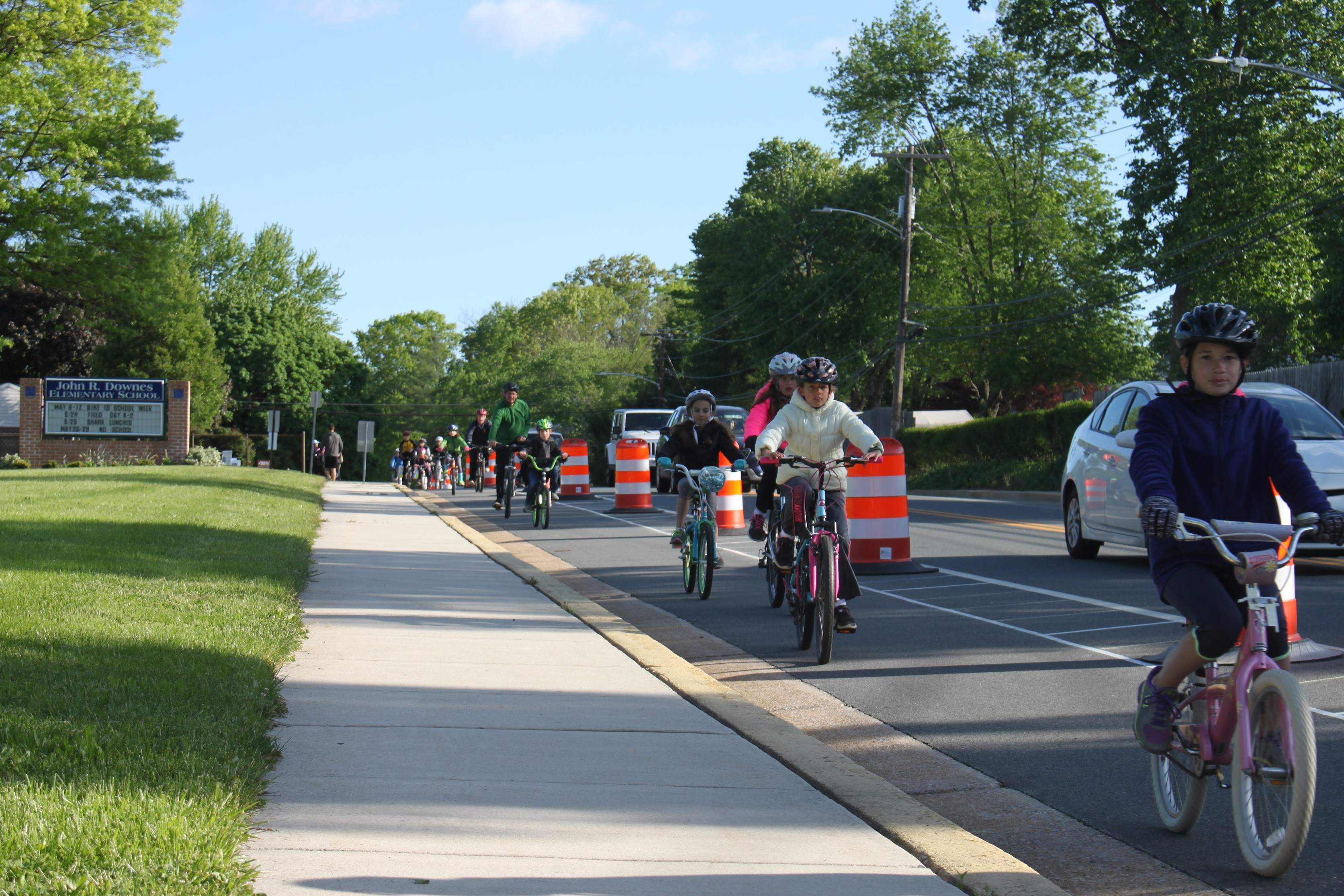 Students ride into school during 2017 Downes Elementary School Bike to School Week