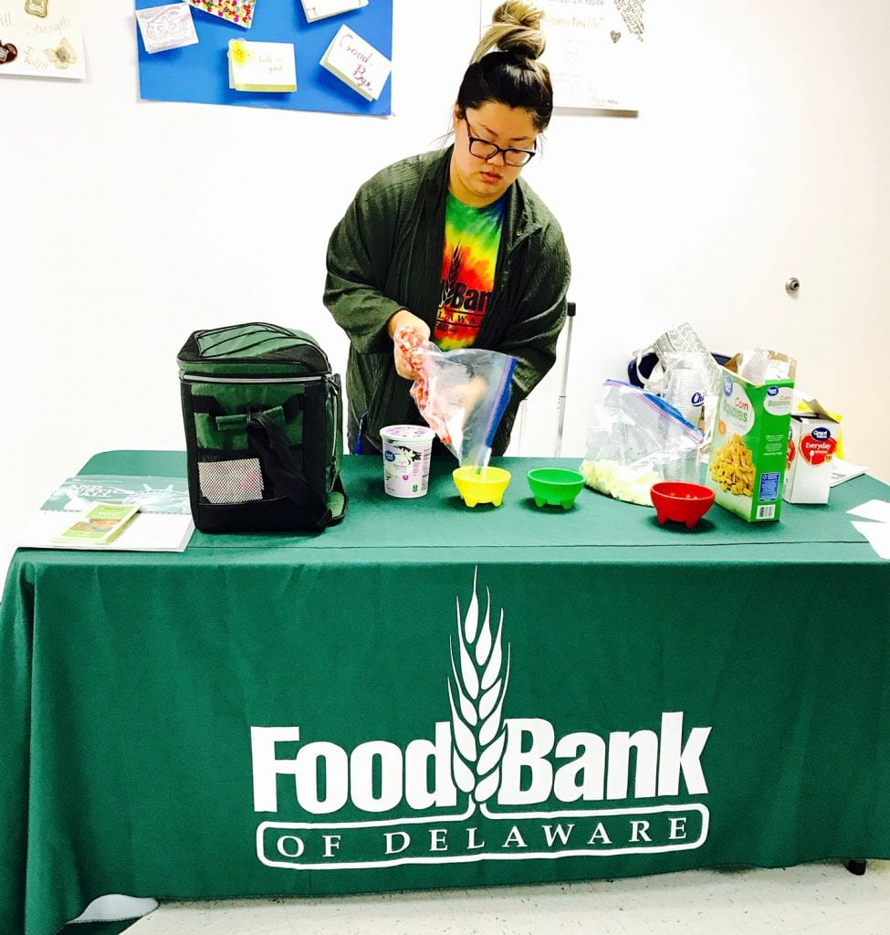 Image showing a food bank WIC Education Specialist conducting a healthy eating demonstration.