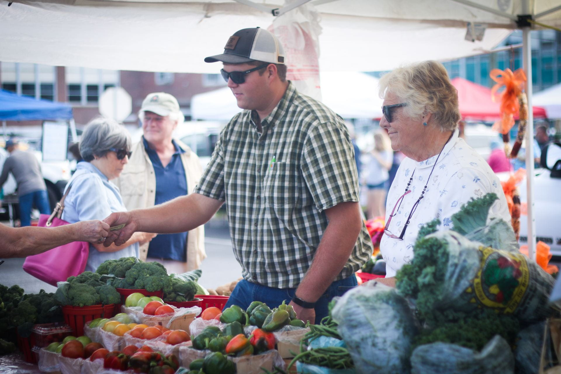 Image showing a man purchases fresh vegetables at the Historical Lewes Farmers' Market.