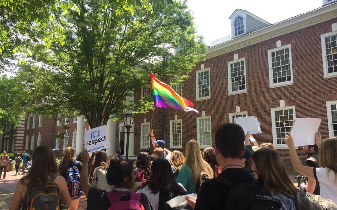 Students rally on the University of Delaware green in this photo by The Review student newspaper