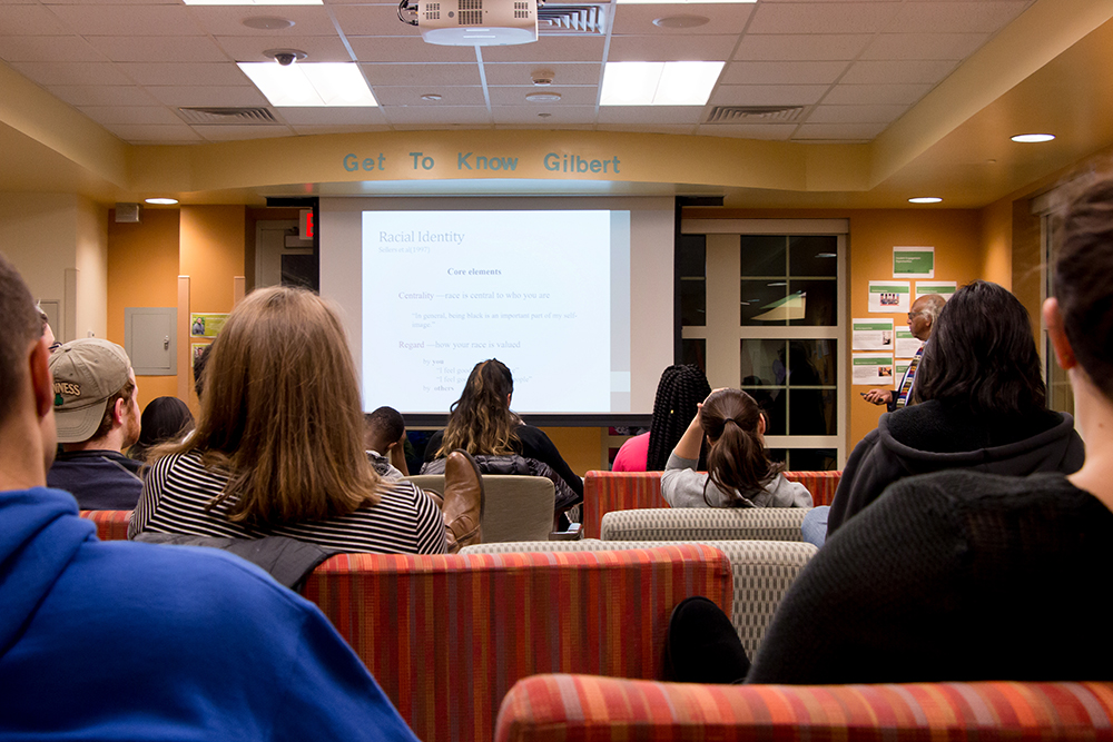 students listen to a presentation on racial identity at the Dive In Diversity Institute winter session program