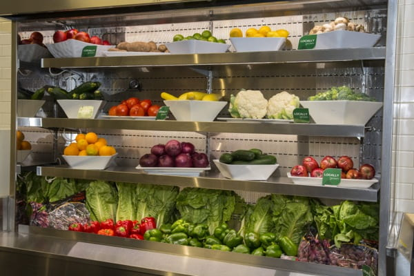 fruits and vegetables are on display at the University of Delaware Caesar Rodney Fresh Food Company Dining Hall which has gluten free and kosher options