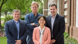 Joe Fox (right), professor of chemistry and biochemistry, collaborated with three UD colleagues on the work that has produced an important new catalytic tool. They are (from left) Joel Rosenthal (chemistry and biochemistry); Colin Thorpe (chemistry and biochemistry); and Xinqiao Jia (materials science and engineering).