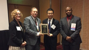 The University of Delaware's Yushan Yan (second from right) has been selected to receive the 2016 Nanoscale Science and Engineering Forum Award from the American Institute of Chemical Engineers